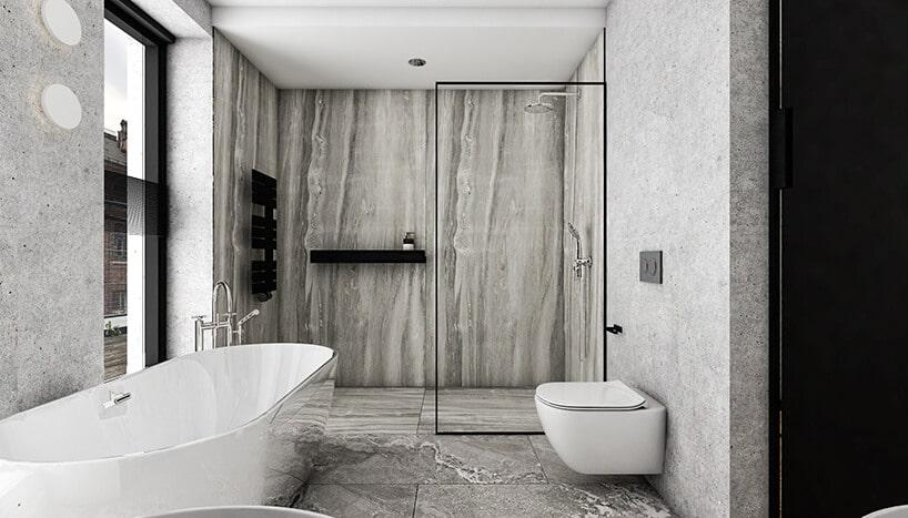 łazienka zdużą wolnostojącą wanna wbetonowym wystroju
