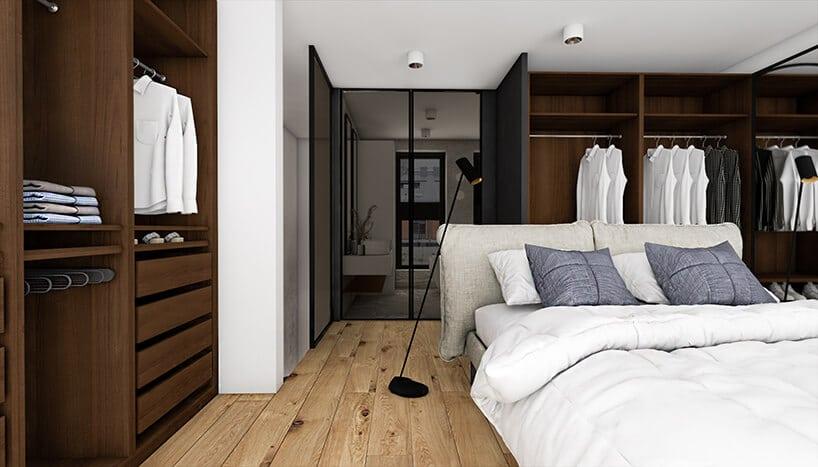 duża przestrzeń na szafy wsypialni zdeskami na podłodze