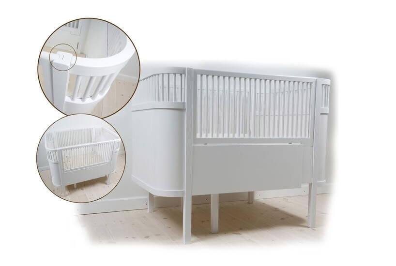 białe łóżeczko zmożliwością dostosowania do wieku dziecka