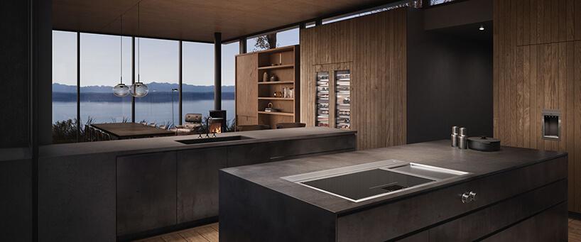 duża nowoczesna kuchnia wykończona drewnianymi deskami na tle widoku na jezioro