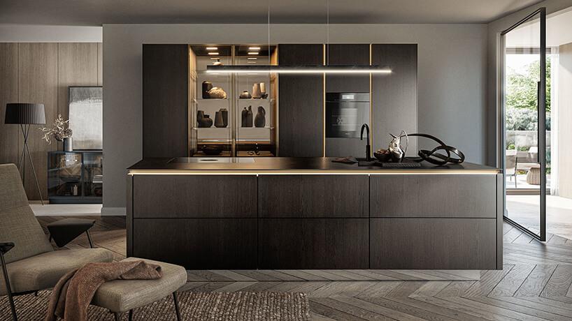 elegancka ciemna zabudowa kuchenna ze złotymi akcentami wnowczenym wnętrzu