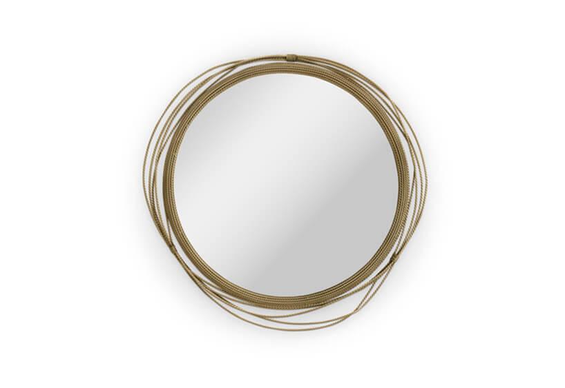 okrągłe lustro ze złotą obwolutą