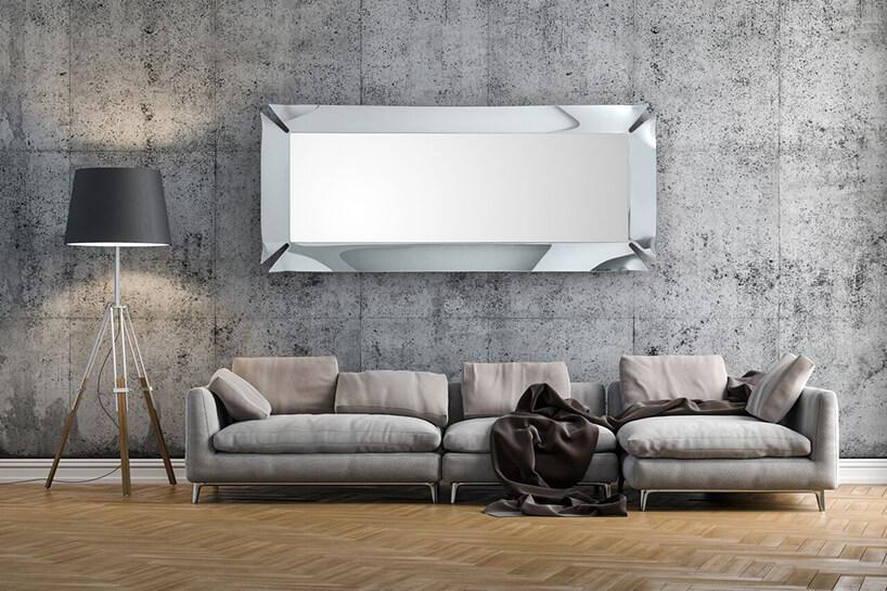 wyjątkowe lustro od J&J glass & design zwyjątkową metalową chromowaną ramą znacięciami wnarożnikach