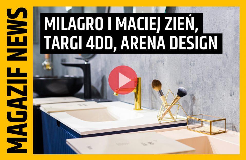 nowoczesna umywalka w niebieskiej szafce ze złotą armaturą i dodatkami na tle betonowej ściany