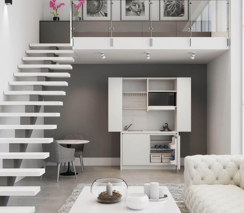 szaro-białe wnętrze zotwartą białą szafą