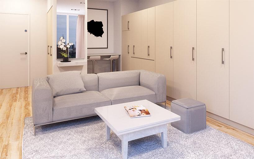 jasny salon zmałym białym stolikiem rozkładanym wwyższy stół