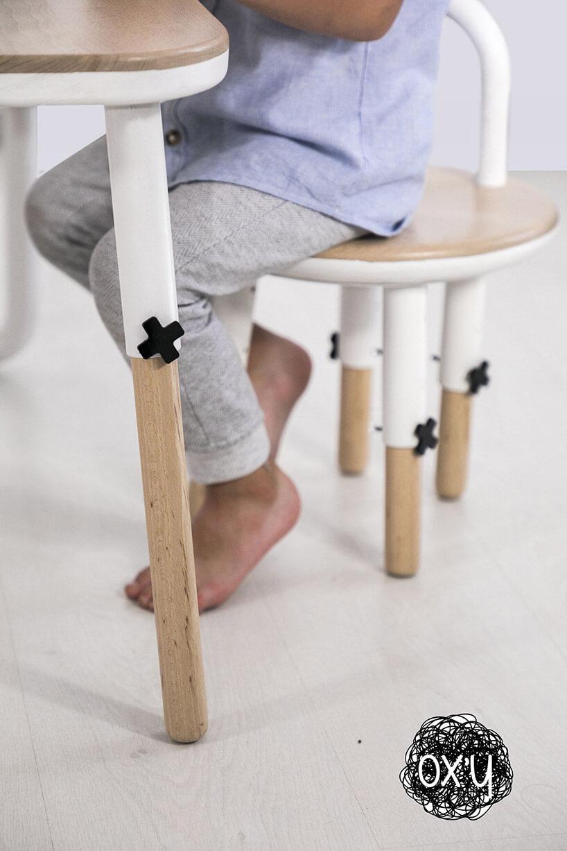 dziecko siedzące na krzesełku OX'Y