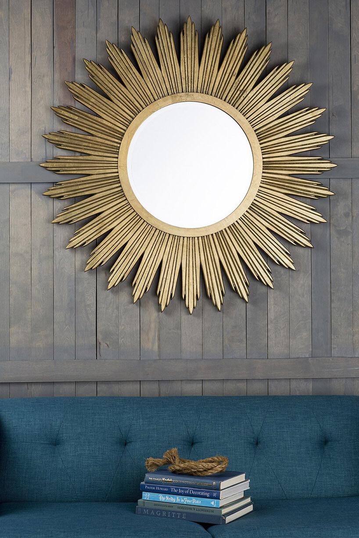 duże okrągłe lustro zmotywem słońca