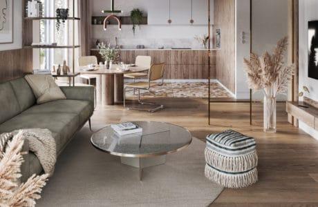 duże wnętrze w beżowych pastelowych kolorach ze stolikiem ze szkła oraz po obrysie złotym zdobieniem