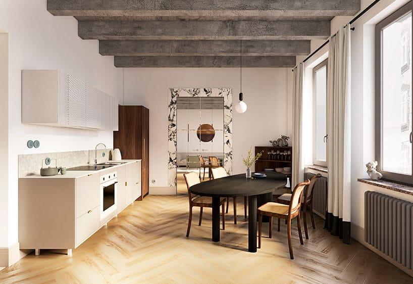 jasna kuchnia zjadalnia zbeżową zabudową zczarnym owalnym drewnianym stołem