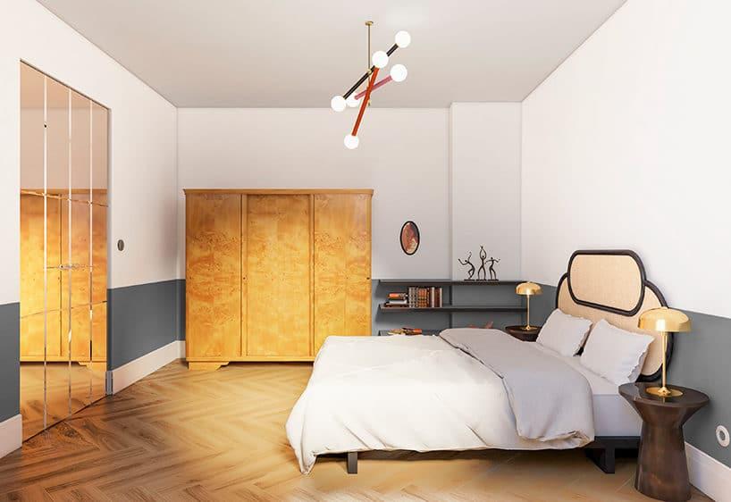jasna sypialnia zdrewniana podłogą zdużym lustrem