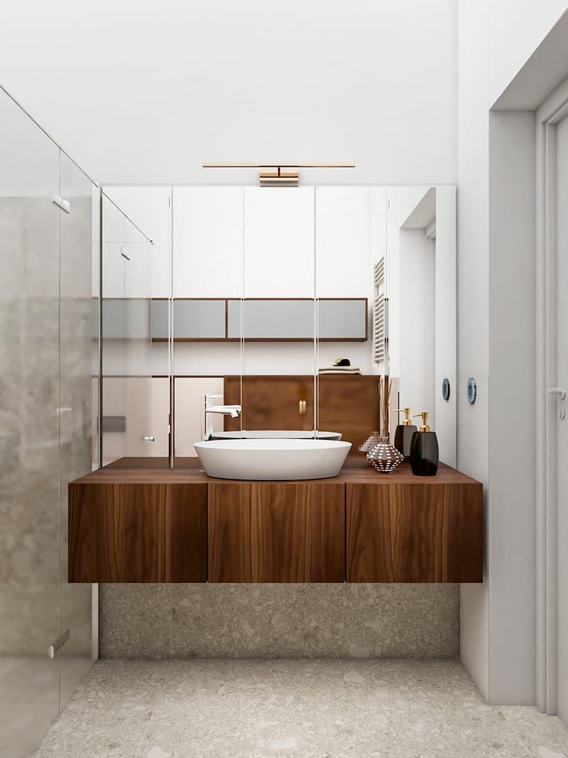 jasno szara łazienka zpodwieszaną drewnianą szafką pod umywalką