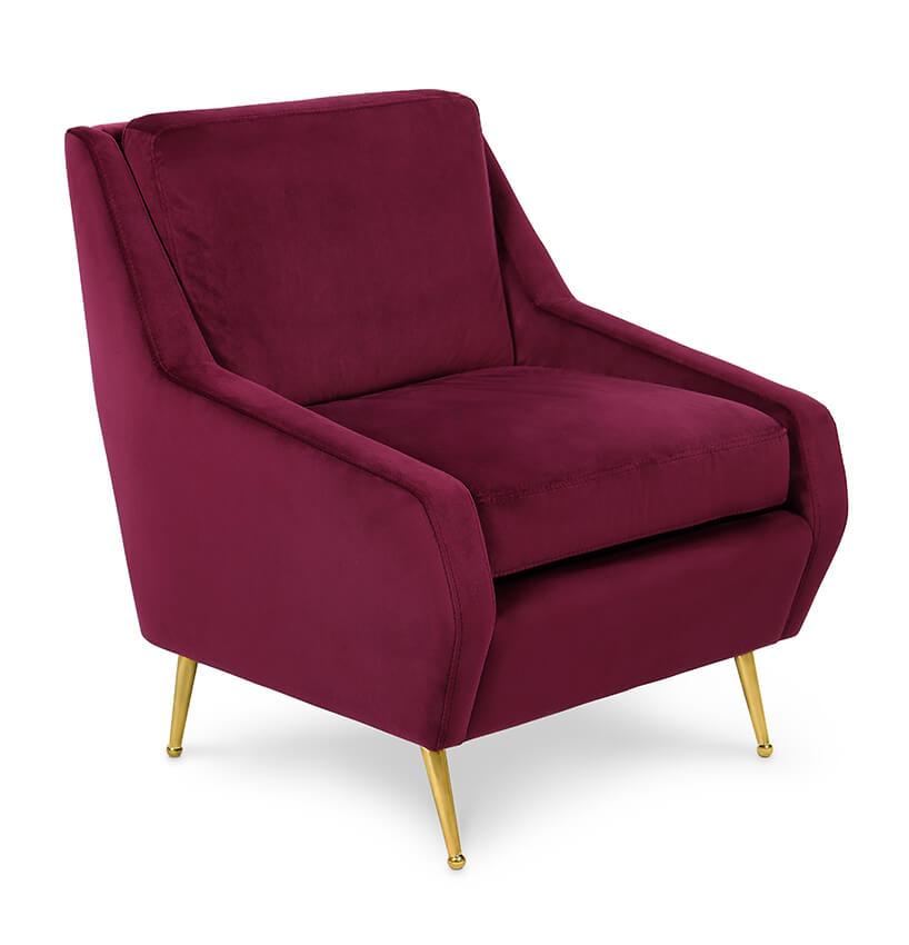 modernistyczne wnętrze Ravenswood Residence elegancki bordowy fotel ze złotymi nogami