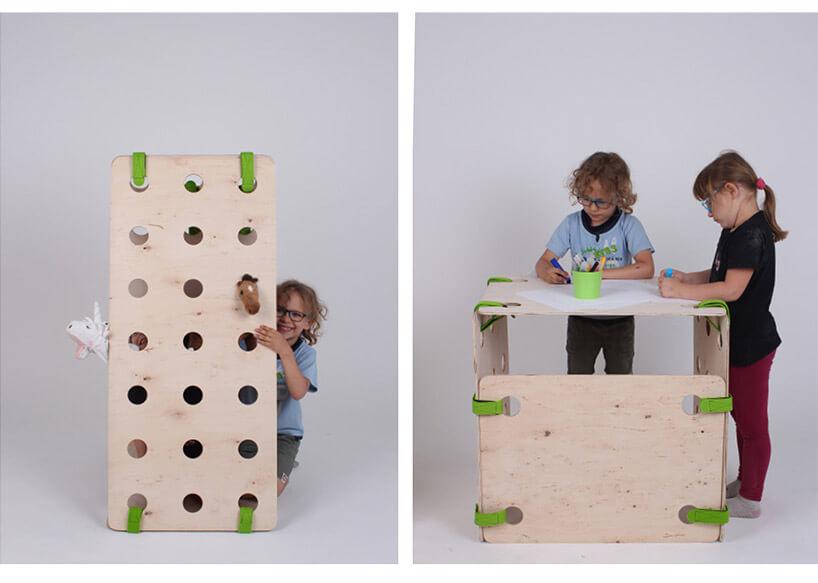 dzieci podczas zabawy przy ściance istolik dots