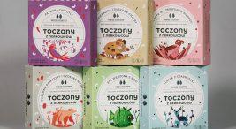 różnokolorowe papierowe opakowania produktów znerkowca zrysunkami zwierząt