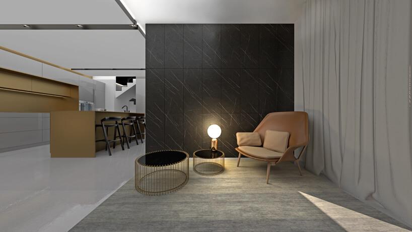 aranżacja wnętrza zdwoma wyjątkowymi stolikami idużym brązowym fotelem na tle czarnej kamiennej ściany