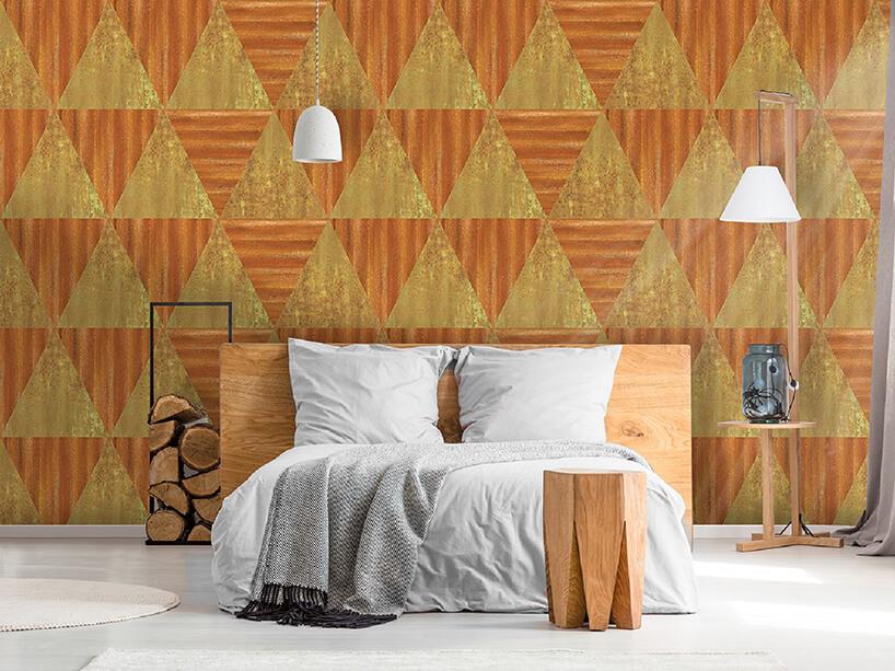 pomarańczowo złota tapeta Pyramid waranżacji sypialni zdrewnianymi elementami