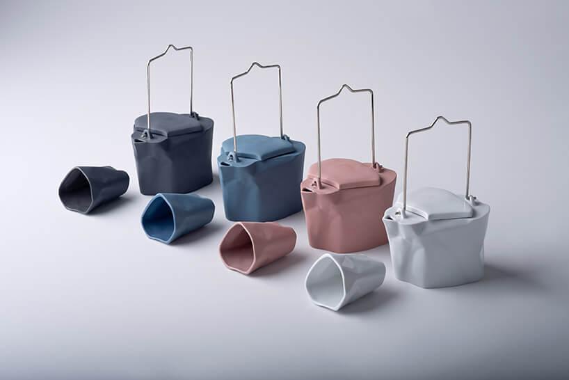 pogięty zestaw ceramiczny imbryka zkubkiem