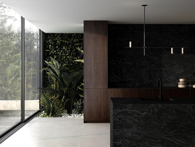 elegancka ciemno brązowa kuchnia zczarnym kamieniem na ścianie iwyspie kuchennej