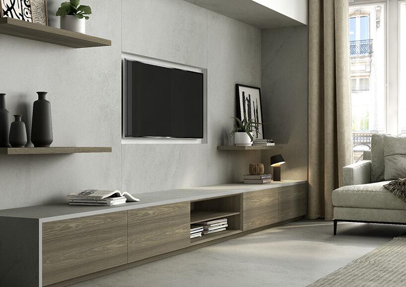 nowoczesny salon ze ścianą wykończoną szarym kamieniem od Cosentino wokół telewizora