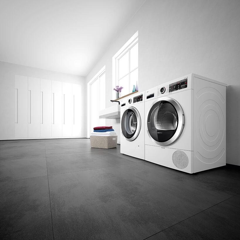 nowczesna suszarka samoczyszcząca Bosch obok nowoczesnej pralki Bosch na czarnej podłodze