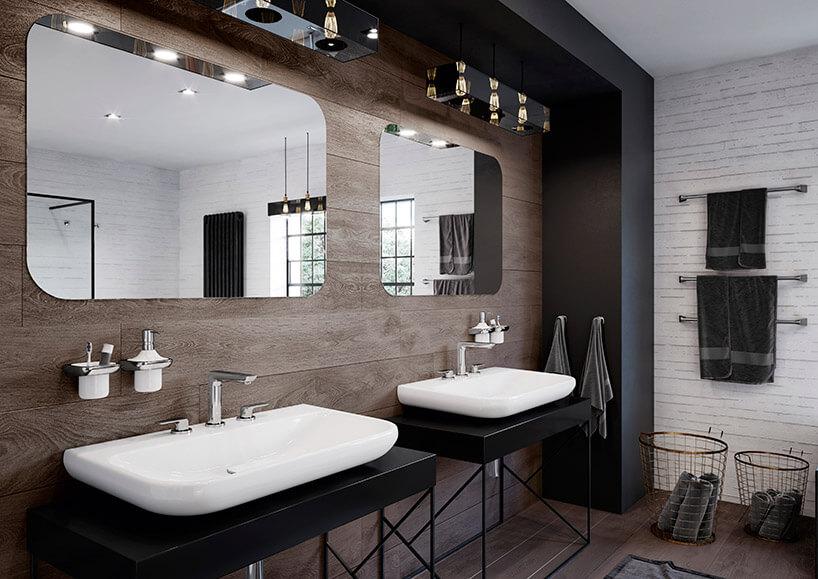 dwie wolnostojące umywalki wbrązowej łazience