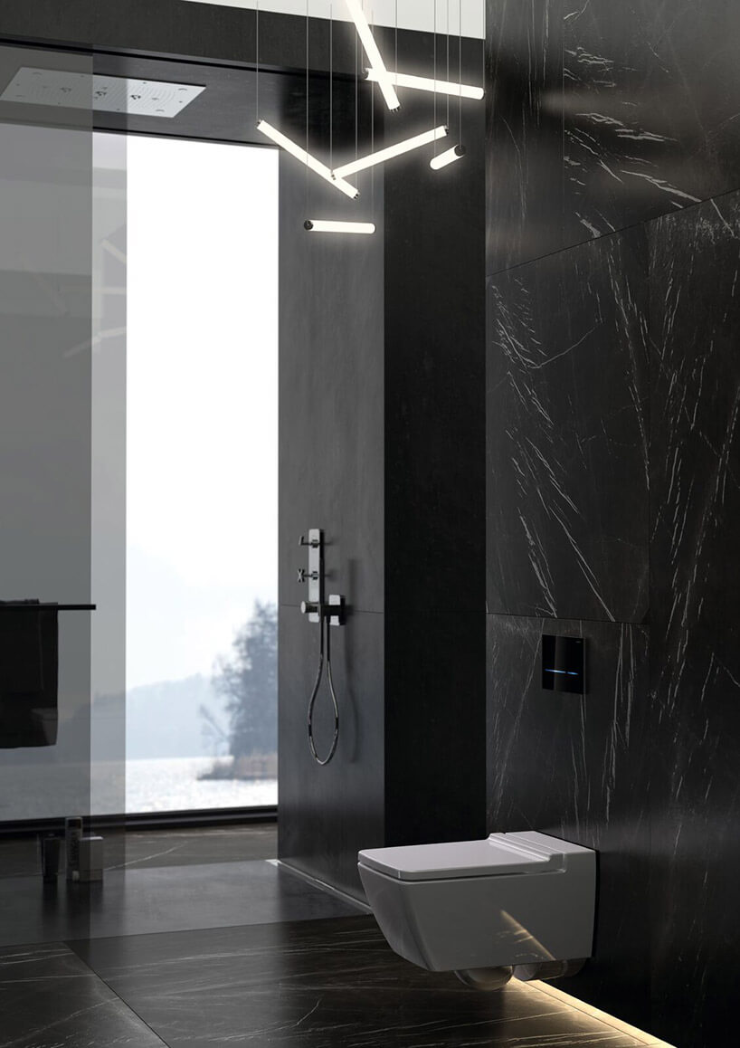 aranżacją wczarnej łazience armatury Geberit