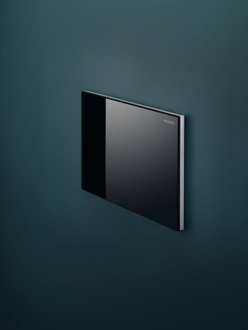 czarny przycisk spłukujący