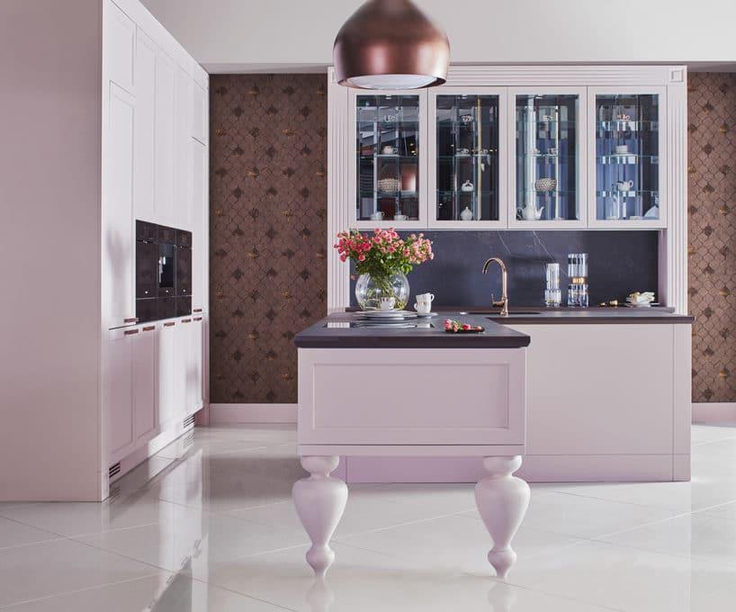 różowa elegancka kuchnia S4 zkolekcji STYLE od ernestrust zwyspą na wysokich nogach na białej podłodze