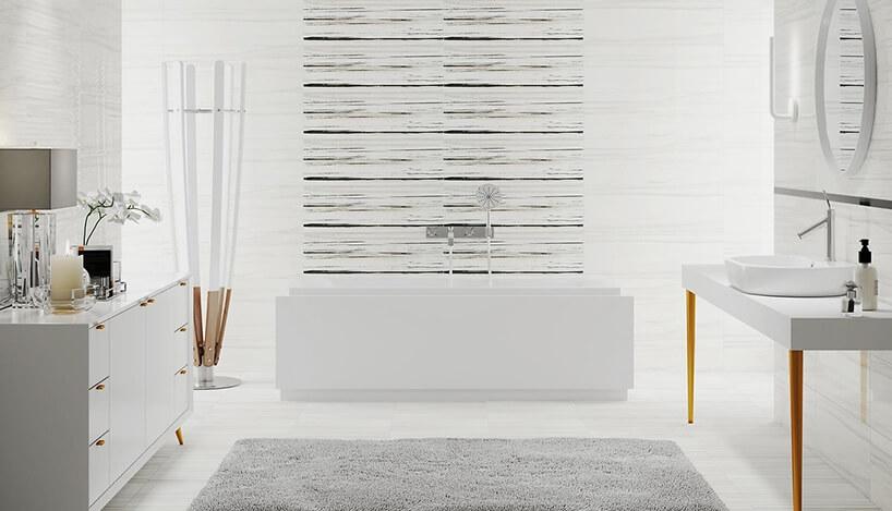 nowoczesna biała łazienka kwadratową wanną na tle płytek Artistic Way od Opoczno