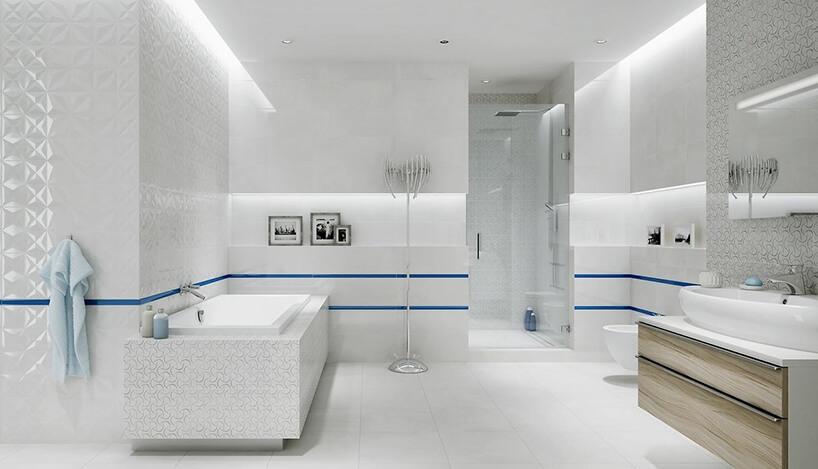 biała nowoczesna łazienka wwieloma ostrymi wykończeniami zpodłużnymi wnękami zdużą wanną zabudowaną płytkami zbłyszczącym akcentem
