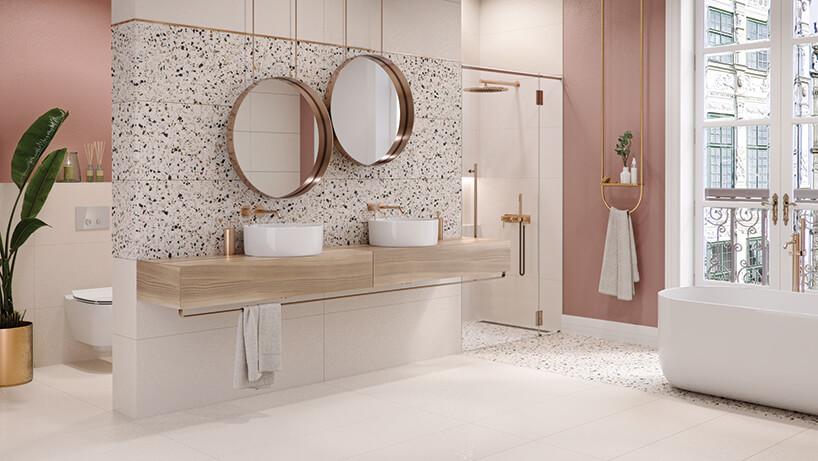 nowoczesna biała łazienka dwoma umywalkami na drewnianym blacie pod dwoma okrągłymi lustrami wramce zblachy na tle płytek wkropki