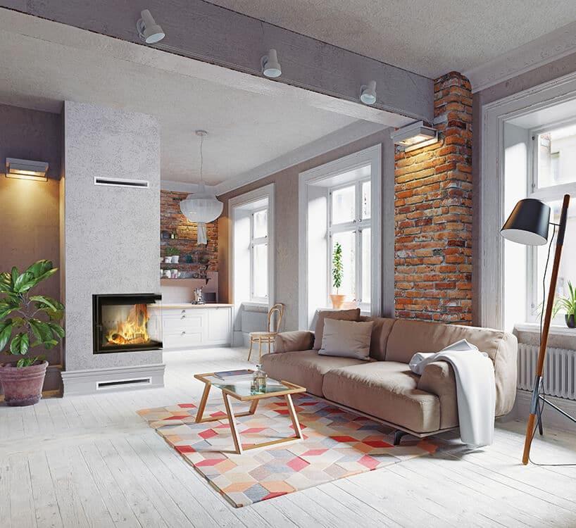 kolorowy dywan zbryłami 3d przy szarej kanapie obok ceglastego fragmentu ściany