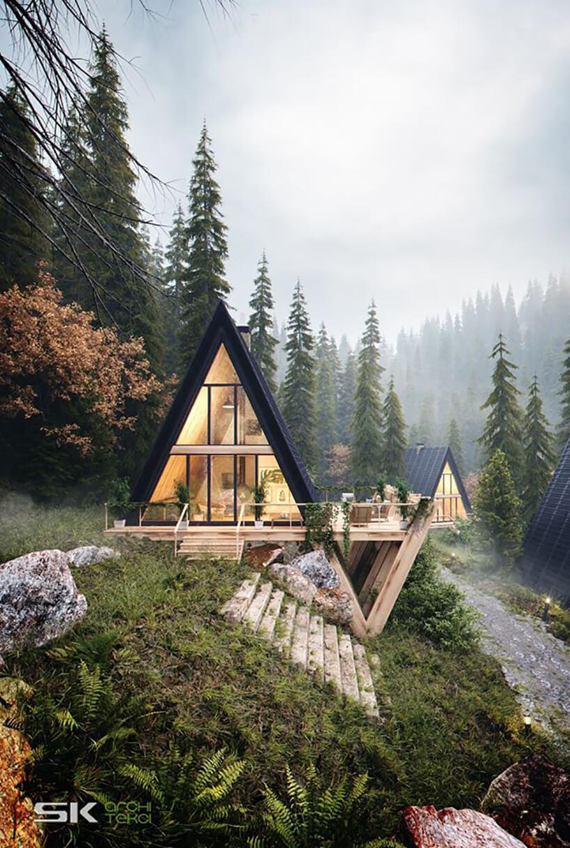 nietypowy dom zczarnym pokryciem dachowym oraz deskami na skarpie