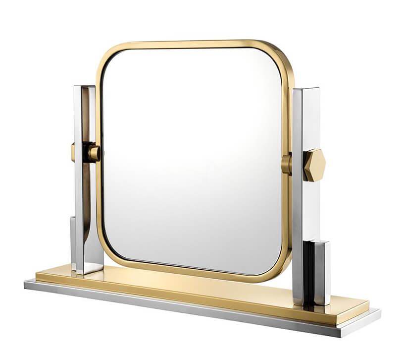 wyjątkowe złote Lustro stojące Carmen od Eichholtz wzłotej ramce na dwóch mocowaniach zmożliwością obracania