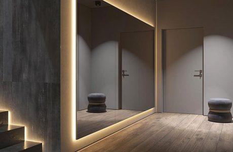 nowoczesny przedpokój z dużym podświetlonym lustrem