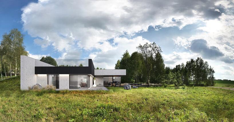 projekt domu od REFORM Architekt widok zboku na betonową ścianę zdużymi okna iprzeszklonym górnym tarasem
