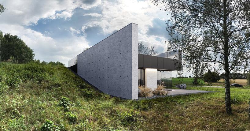 projekt domu od REFORM Architekt widziany ztyłu betonowa ściana znikająca wskarpie
