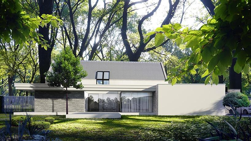 nowoczesny dom typu stodoła wbiałym wykończeniu na zielonej działce