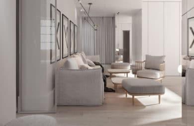 nowoczesne wnętrze salonu z jasną podłogą z szarymi ciepłymi materiałami kanap przy ścianie z ramami