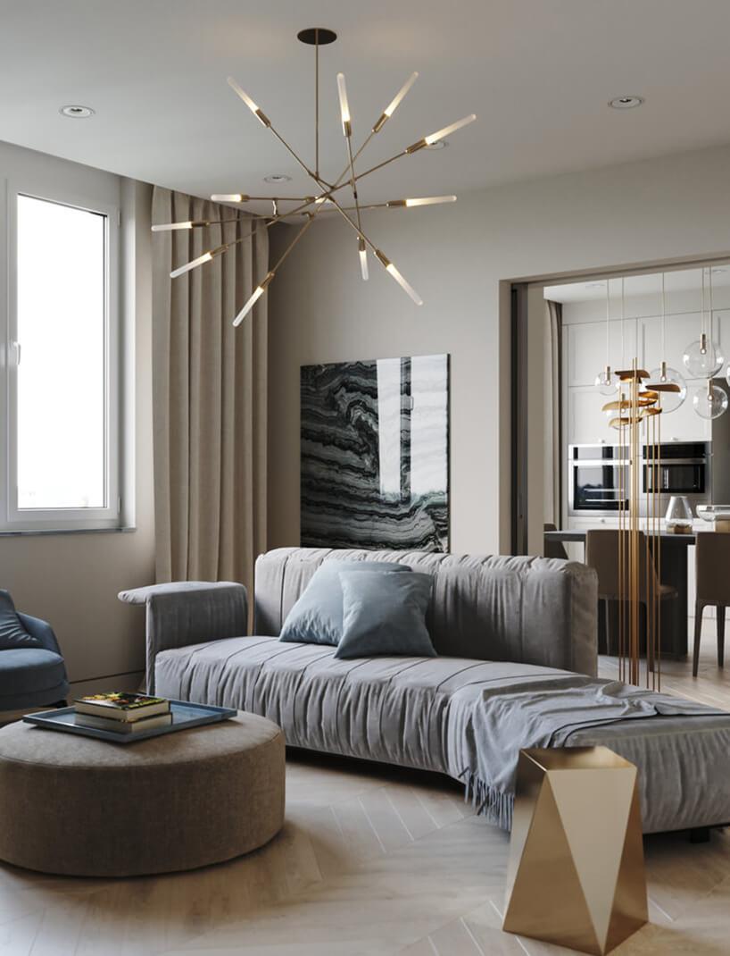 wyjątkowy żyrandol Dawn od Matthew McCormick ze świecących prętów wsalonie zniebieską sofą