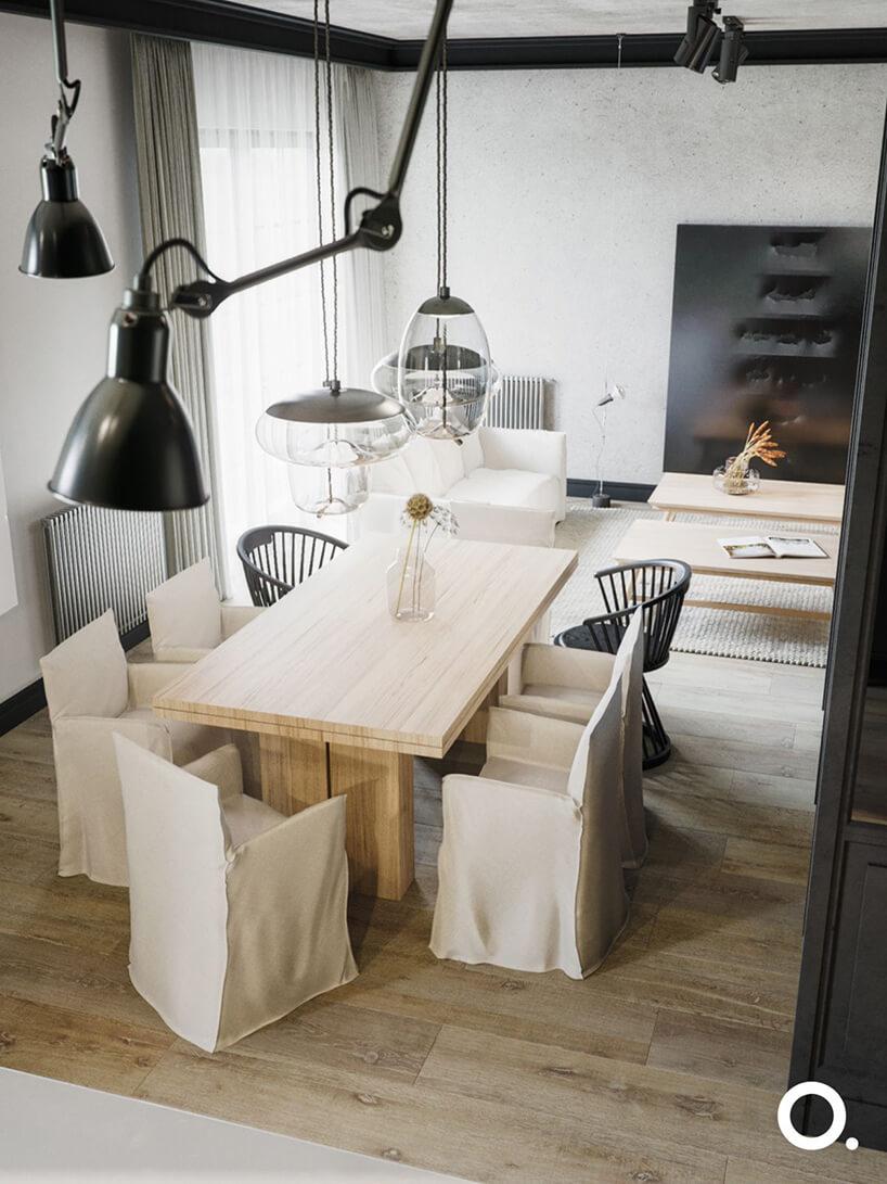 drewnianym stół zkrzesłami wnowoczesnym salonie zdrewnianą podłogą