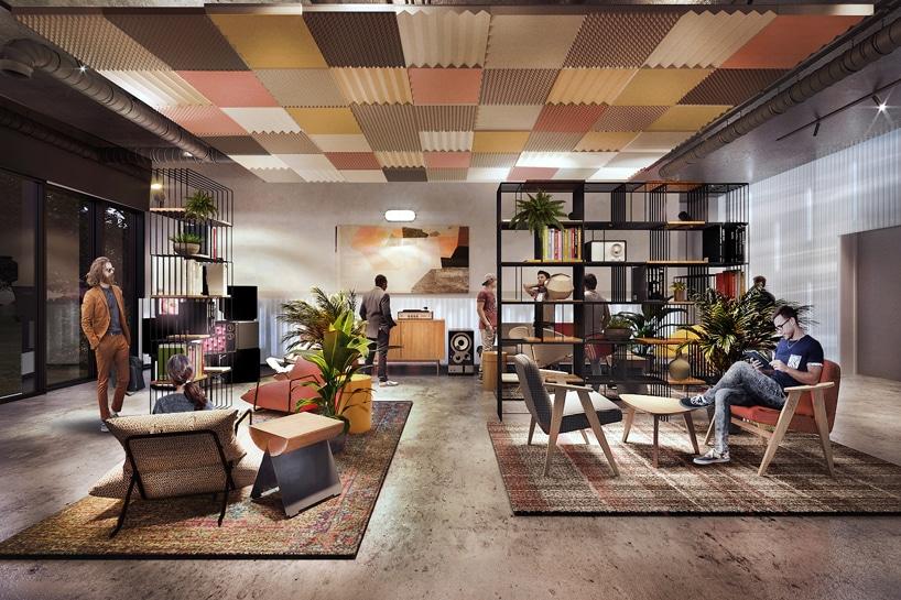 wnętrze Cukrownia Żnin Parku Industrialnego projektu MIXD przestrzeń wspólna zróżnymi siedziskami zkolorowymi panelami na suficie