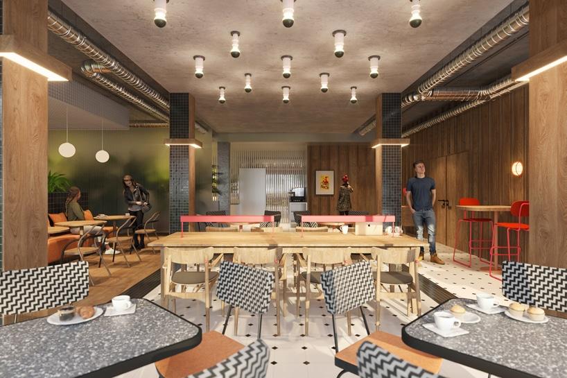 wnętrze Cukrownia Żnin Parku Industrialnego projektu MIXD przestrzeń wspólna zdrewnem na ścianach ze stolikami