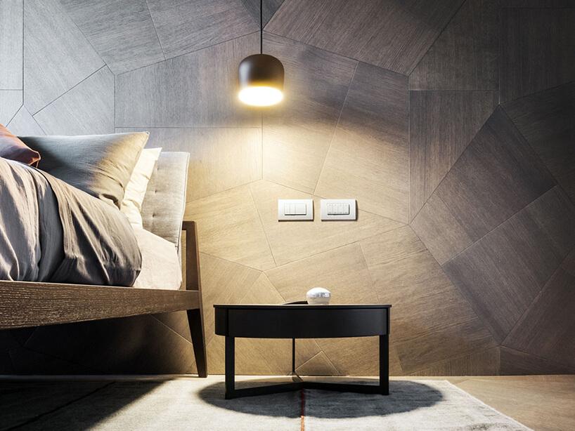 elegancki penthouse od Zaha Hadid zdjęcie małe stolika przy łóżki na tle ściany zdrewnianych nieregularnych desek
