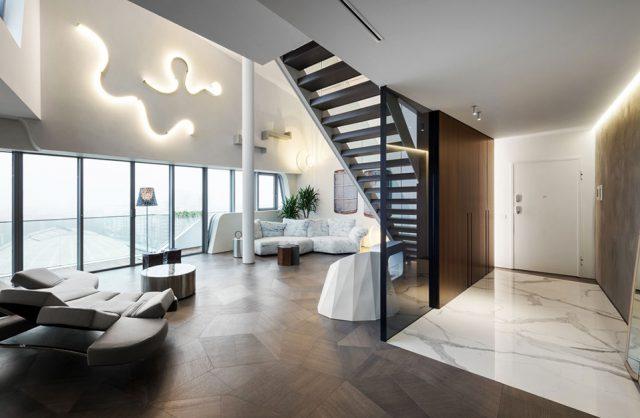 elegancki penthouse od Zaha Hadid elegancki wysoki salon z ciemną drewniana podłoga i ciemnymi schodami na górę