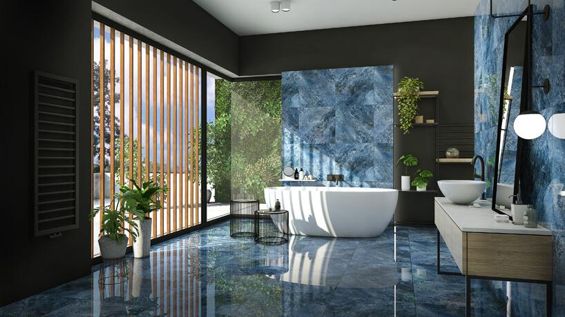 duża łazienka zoknem od sufitu do podłogi iwzorzystymi płytkami