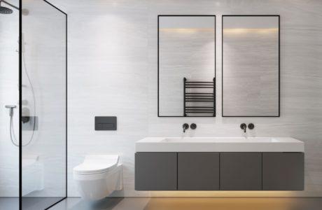 szara łazienka z prysznicem wc i dwoma lustrami nad umywalką z podświetleniem