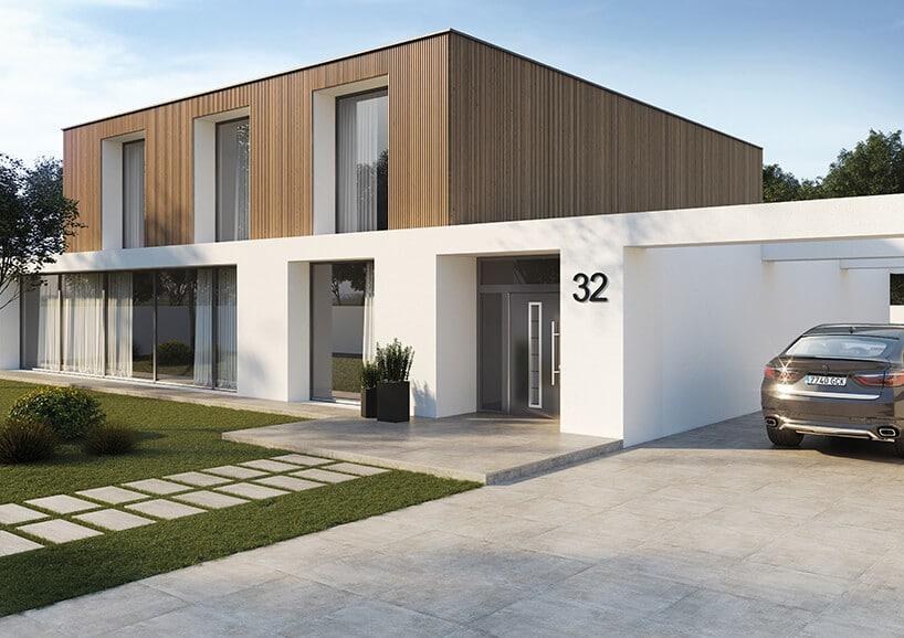 nowoczesny dom zpodjazdem wyłożonym płytkami ceramicznymi