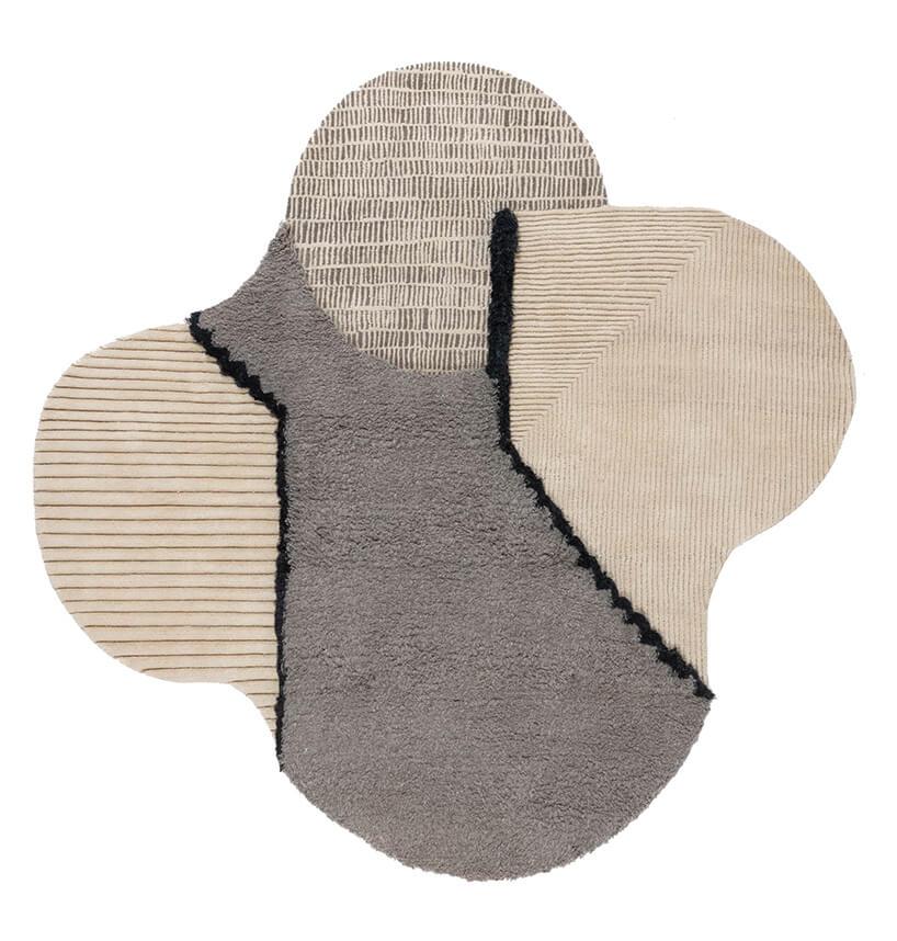 wyjątkowy dywan od CC Tapis wszaro bezowych kolorach wnieregularnym kształcie